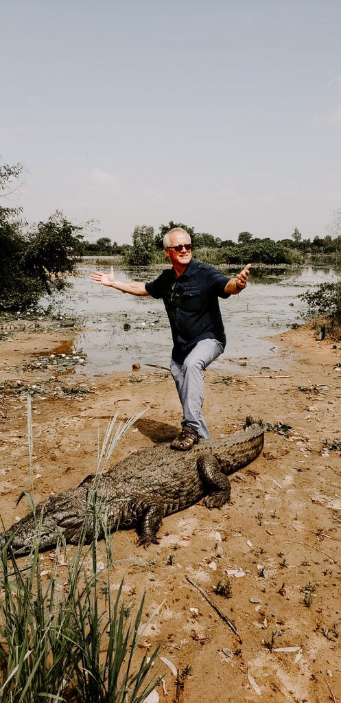 Steve Harling with his foot on a Crocodile