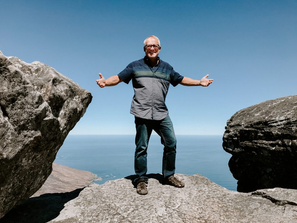 Steve Harling standing on a rock overlooking the ocean